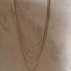 Long gold and white necklace